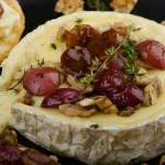 Baked Brie With Nuts and Grapes