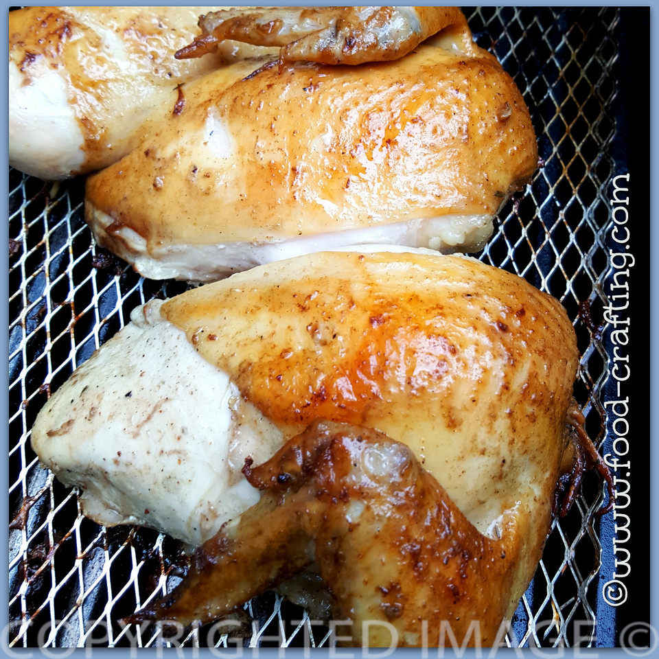 Two chicken quarters basted with apple cider vinegar marinade | food-crafting.com