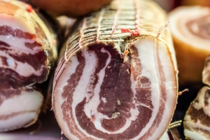 Home delivered meat seafood @studiograndouest - French specialty pork delicatessen and bacon called ventreche at butcher