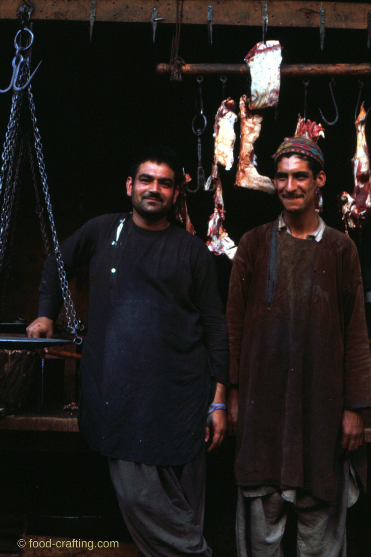 Pieces of meat hanging in a butcher shop in Afghanistan - About De Ashton | © food-crafting.com