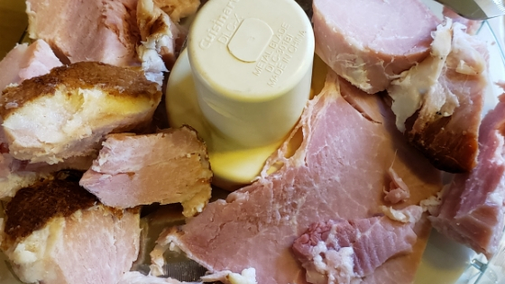 Making best ham salad - ham chunks in processor
